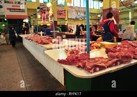 Fresh meat being sold straight from the counter at Simferopol market. Crimea, Ukraine. - Stock Image