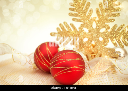 beautiful christmas background with decoration in gold and red - Stock Image