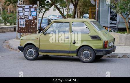 Old dinged Fiat Polski vintage car parked on streets on the coastal town.  Kotor, Montenegro - Stock Image