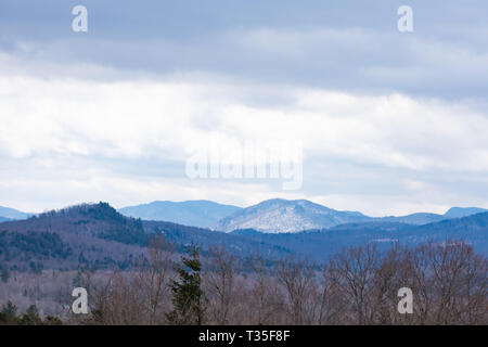A view of Adirondack Mountains, NY USA in late winter on an overcast day - Stock Image