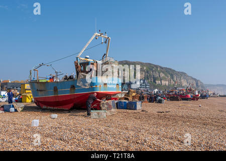 Fishermen load cuttlefish nets on the Old Town Stade. - Stock Image