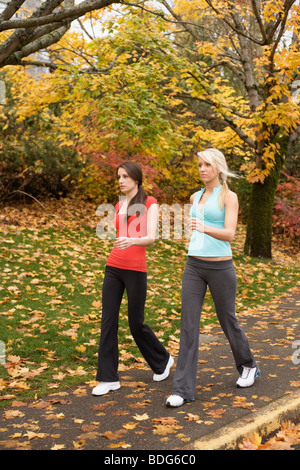 Two young women walking in fitness attire - Stock Image
