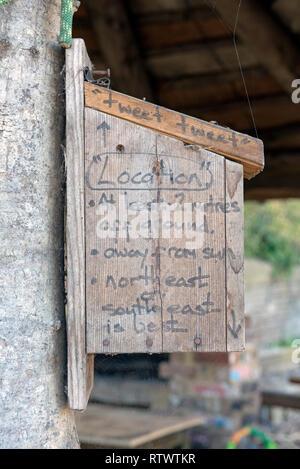 Wooden nestbox with advice for it's location written onto the side. - Stock Image