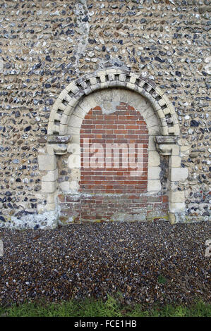 Norman north door, now bricked up. St Edmund's Church, South Burlingham, Norfolk - Stock Image