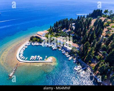 The old harbor and fishing village Kouloura. Corfu (Kerkyra) Island, Greece, Europe. Fishing boats and clear blue - Stock Image