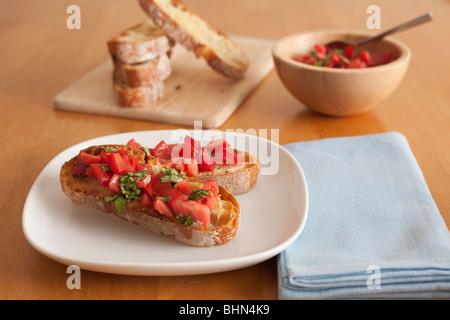 Tomato and basil bruschetta made with crusty Italian cibatta bread - Stock Image