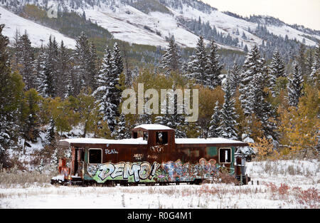 Fall Colors Kananaskis Abandoned Train Car snowfall Aberta - Stock Image