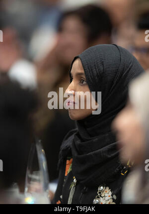 Congresswoman Ilhan Omar of Minnesota's 5th Congressional District listens to a speaker at the annual city-wide iftar dinner in Austin, Texas, in honor of the 14th day of Ramadan. - Stock Image