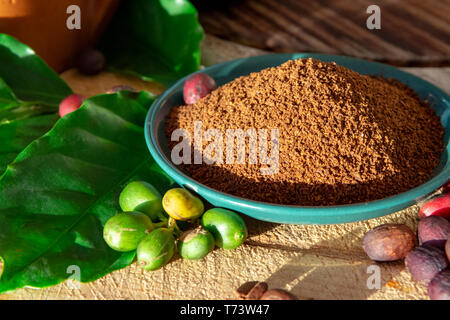 Red mature and dried organic arabica coffee beans, fresh ground coffee on bio coffee farm - Stock Image