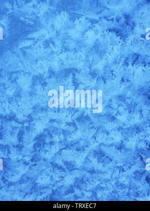 Snow crystals form beautiful snow pattern on frozen icy river. Snowflake background. - Stock Image