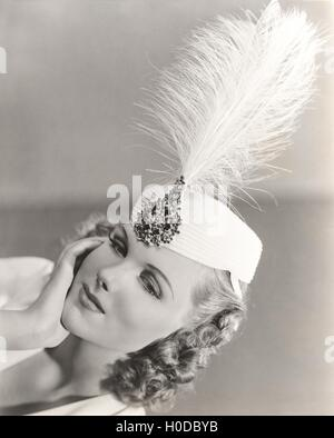 Feather in her cap - Stock Image