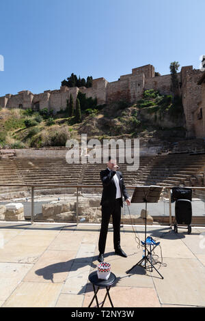Street entertainer Spain - a man singing opera at the roman theatre, Malaga, Andalusia Spain Europe - Stock Image