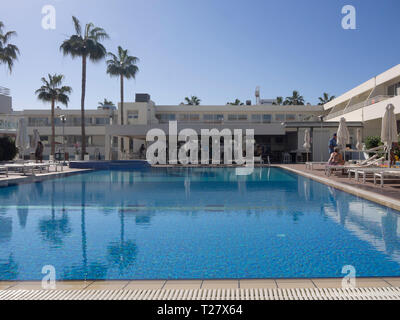 Perfect holiday in Cyprus, a sunny day by the swimming pool in Ayia Napa, at Melpo Antia Luxury Apartments - Stock Image