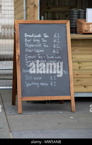 A chalkboard menu for a street cafe showing items and prices in white lettering at Liverpool May 2018 - Stock Image