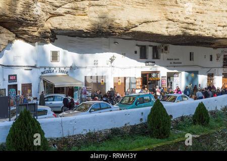 Setenil de las Bodegas, Cadiz Province, Spain.  Commonly known simply as Setenil.  Houses, now mostly restaurants, built into overhanging rock walls. - Stock Image