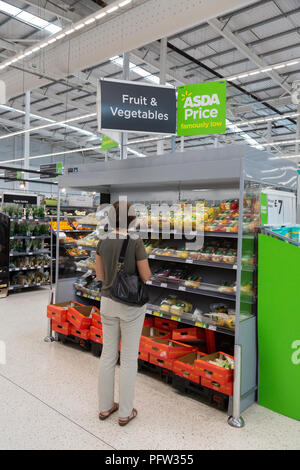 Model released customer shopping for food in an Asda supermarket, Asda, Bury St Edmunds, Suffolk UK - Stock Image