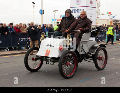 Mr Willem Van Der Horst, driving a 1902, Knox, across the finishing line of the 2018 London to Brighton Veteran Car Run - Stock Image