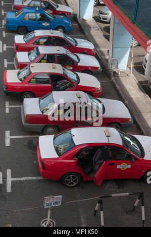 In Malaysia, as elsewhere, the established taxi industry is threatened by the emergence of digitally-based ride sharing networks. - Stock Image