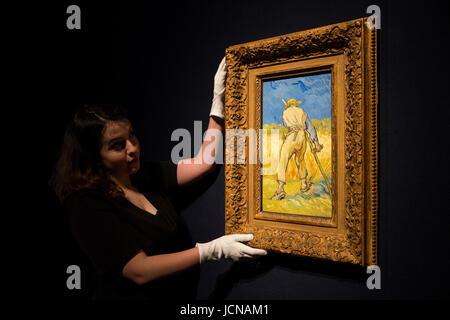 London, UK. 16 June 2017. A Christie's employee handles the painting Le moissonneur (d'apres Millet), 1889, - Stock Image