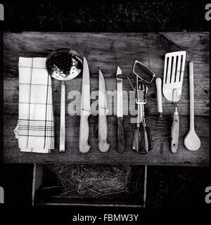 Directly Above Shot Of Kitchen Utensils On Wooden Table - Stock Image