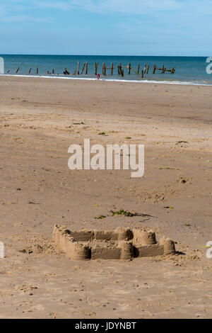 Sandcastle on the wonderful sandy and quite secluded beach at Happisburgh in Norfolk, England, UK - Stock Image