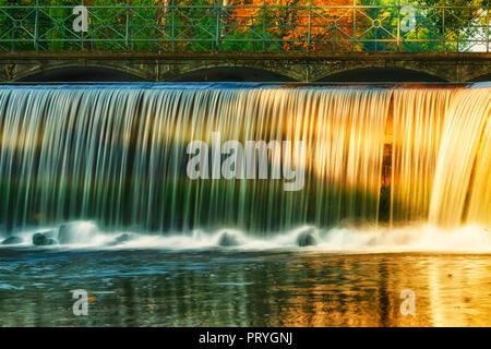 Water fall and sun - Stock Image