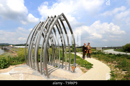 Local artists, husband and wife Jane Fordham and David Parfitt, unveil a memorial for Shoreham Airshow victims on the banks of the Adur in Shoreham in remembrance to the eleven people who died in the crash in August 2015. - Stock Image