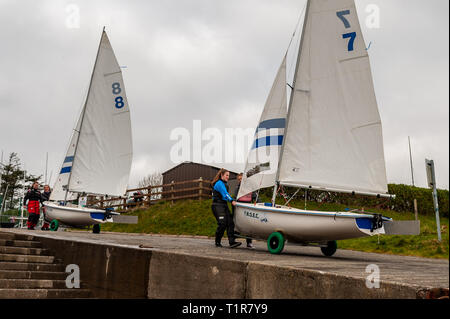 Schull, West Cork, Ireland. 28th Mar, 2019. Competitors launch their boats for a day's sailing on the second day of the Munster Schools Team Racing Championships, which is being held at the Fastnet Marine and Outdoor Education Centre in Schull today. The competition comprises of 13 teams of 6 sailors with the winners going on to compete in the National Championships. Credit: Andy Gibson/Alamy Live News - Stock Image