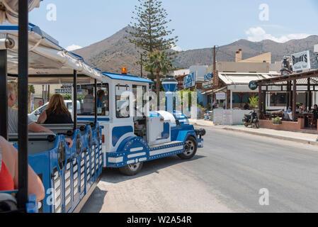 Crete, Greece. June 2019. A tourist road train on a route leaving Elounda enroute to Plaka a seaside resort in the Lassithi region of Crete. - Stock Image