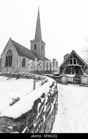 St Giles Church in Bredon, Worcestershire in the snow - Stock Image