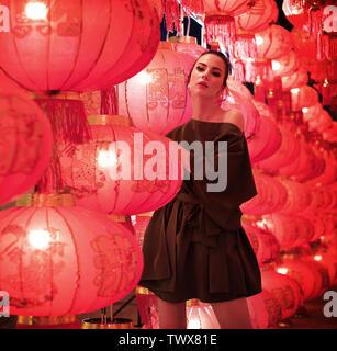 Portrait of a prettywoman enjoying an asian festival - Stock Image