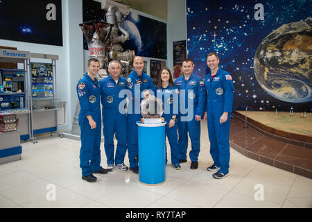 International Space Station Expedition 59 prime and backup crew members pose for a group photo in the Cosmonaut Museum at the Baikonur Cosmodrome March 10, 2019 in Baikonur, Kazakhstan. From left to right are the backup crew members, Drew Morgan of NASA, Alexander Skvortsov of Roscosmos and Luca Parmitano of the European Space Agency, and the prime crew members, Christina Koch of NASA, Alexey Ovchinin of Roscosmos and Nick Hague of NASA. Expedition 59 crew will launch March 14th onboard the Soyuz MS-12 spacecraft for a six-and-a-half month mission on the International Space Station. - Stock Image