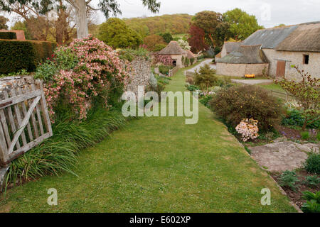 Medieval barns in the estate village of East Quantoxhead. - Stock Image