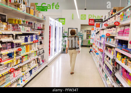Model released customer shopping in an Asda supermarket aisle, Asda, Bury St Edmunds, Suffolk UK - Stock Image