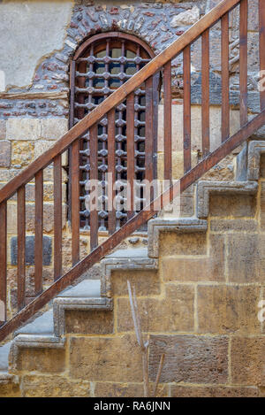 Wooden window and staircase with wooden balustrade leading to historic Beit El Set Waseela building (Waseela Hanem House), Old Cairo, Egypt - Stock Image