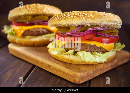 Hamburgers in rustic style - Stock Image