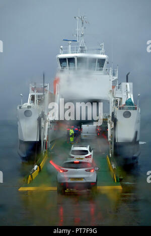 Scotland, UK. 7th Oct 2018. Relieved ferry commuters quickly board the Fishnish to Lochaline Calmac Ferry taking them from the Isle of Mull to the mainland. Many ferries were cancelled due to adverse weather conditions. Credit: PictureScotland/Alamy Live News - Stock Image
