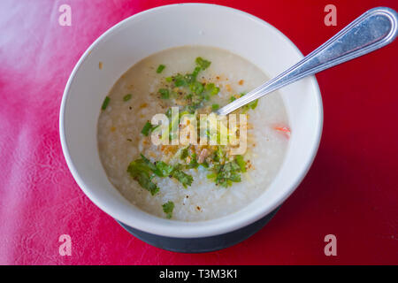 Kao Tom, chicken rice soup, traditional breakfast, Krabi town, Thailand - Stock Image