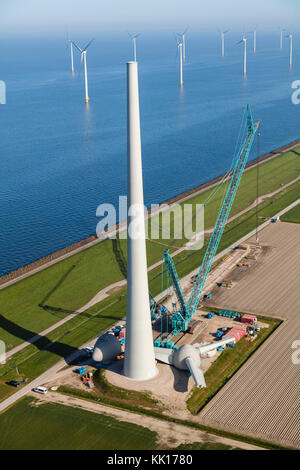 Aerial view of wind turbines under construction by the sea, North Holland, Netherlands - Stock Image