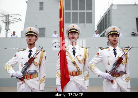 (190423) -- QINGDAO, April 23, 2019 (Xinhua) -- The honor guard of the Chinese People's Liberation Army (PLA) Navy stand in formation before a naval parade staged to mark the 70th founding anniversary of the PLA Navy at a pier in Qingdao, east China's Shandong Province, on April 23, 2019. (Xinhua/Li Gang) - Stock Image