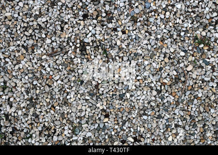 Plenty of little colorful pebble stones creating a beautiful decorative surface. Photographed in Nyon, Switzerland. Closeup photo. Color image. - Stock Image