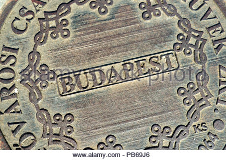 A cast iron manhole cover for drainage in Budapest, Hungary. - Stock Image