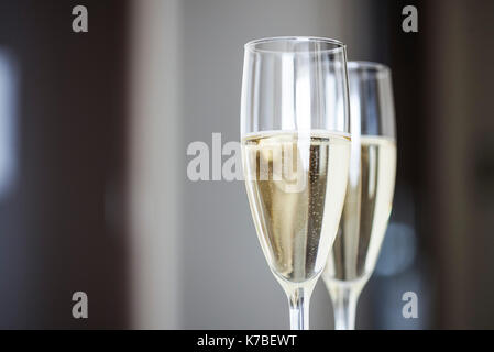 Close-up of champagne in champagne flutes - Stock Image