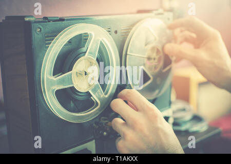 listening old records on vintage audio reel recorder - Stock Image