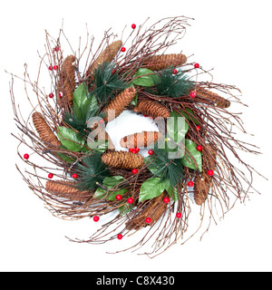Christmas wreath pine cones twigs leaves berries on white background. - Stock Image