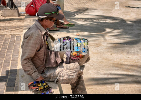 Thailand street vendor with a selection of sunglasses for sale. Thailand, Southeast Asia - Stock Image