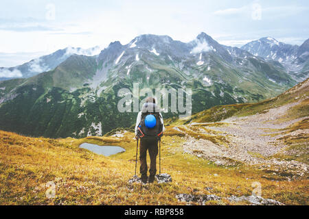 Traveler climbing alone in mountains travel adventure lifestyle  summer vacations activity outdoor - Stock Image