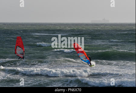 East Wittering, UK. 19th September 2018. Windsurfers brave wild, wet and windy weather  of Storm Ail - our first named storm of the season. Weather was  recorded at the Chichester Bar at 3pm BST  a mean speed of 29 Knots highest gusting  35 .4 Knots The Met Office have issued an yellow weather warning for this area with strong winds and heavy rainfall.Credit Gary Blake / Alamy Live News - Stock Image