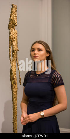 London, UK. 15 June 2017. A Sotheby's employee looks at Grande figure by Alberto Giacometti, est. GBP 15-20m. - Stock Image