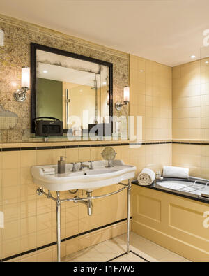 'Retro bathroom with map tilework in The Zetter Townhouse in London, England' - Stock Image